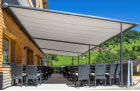 Image of pergolas fitted over seating area outside a cafe.
