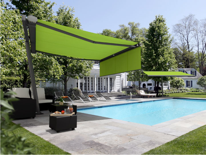 Image of freestanding planet fitted with retractable awnings providing shade next to a garden swimming pool