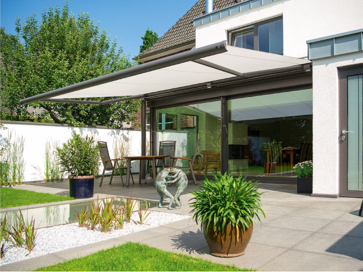Image of cassetted awning fitted to rear of residential house covering the patio.